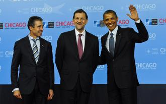 Rajoy entre Obama i Rasmussen a Chicago
